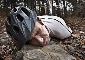 Photo of a cyclist on the ground