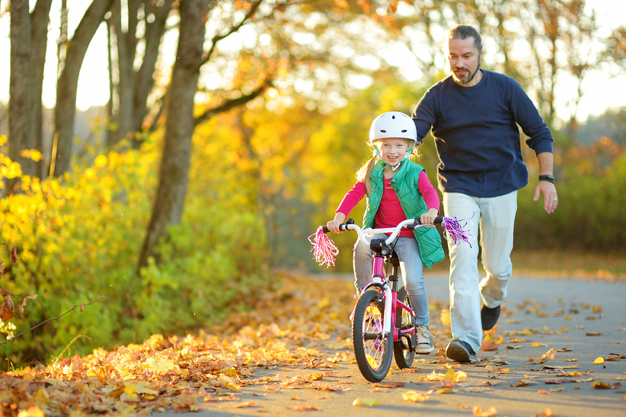 Picture of father and daughter on bicycle