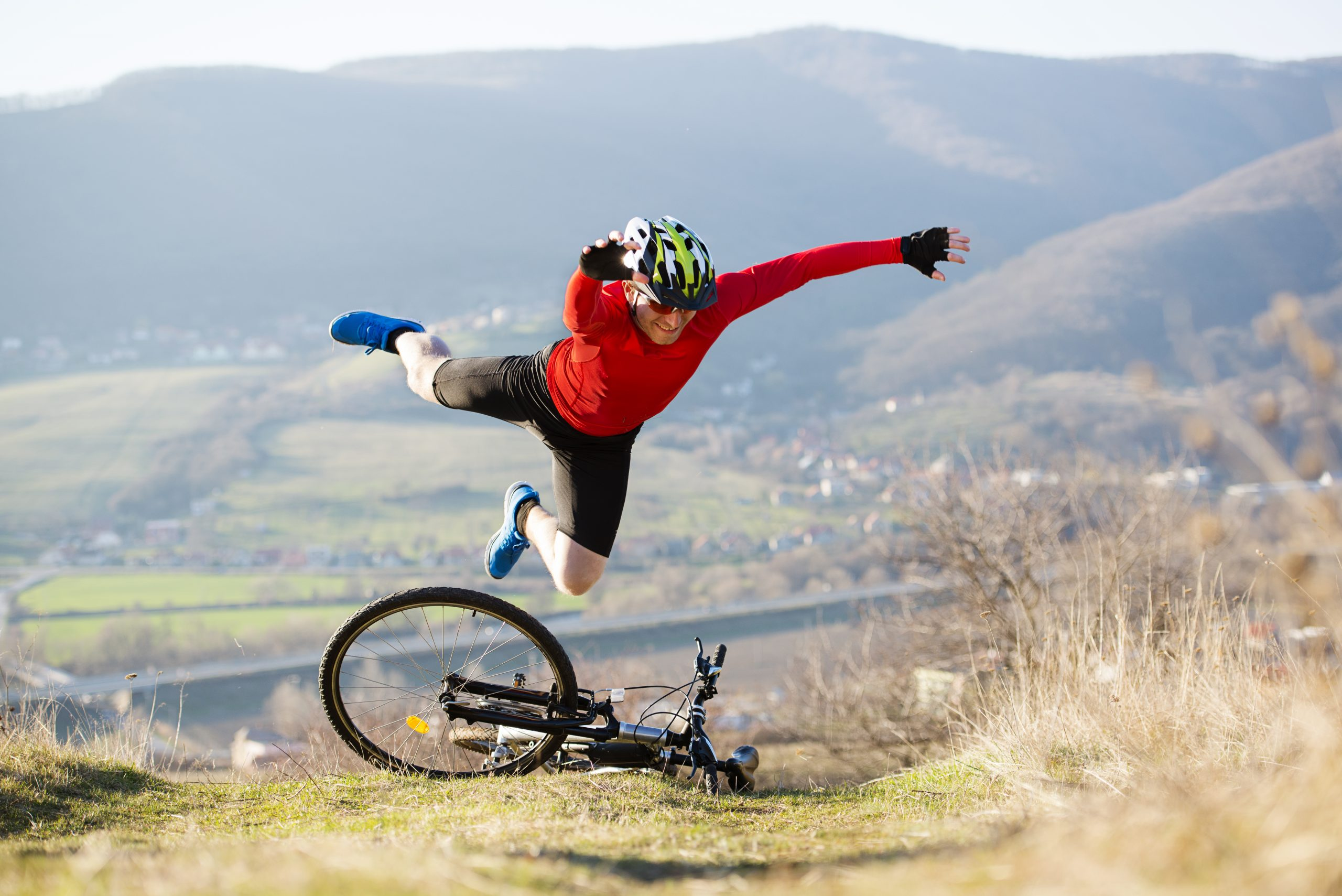 Picture of man flying off bicycle